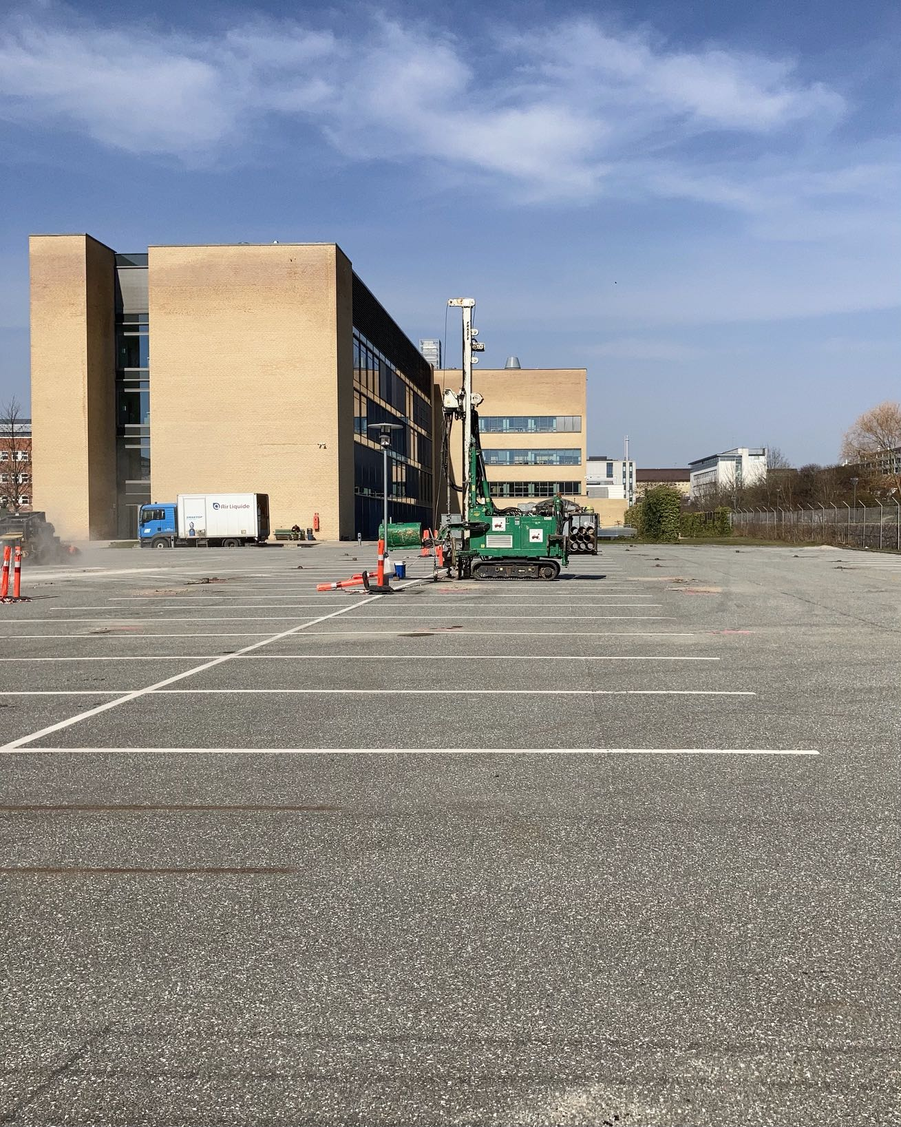 "This is a picture of a drill in the Lundbeck parking lot close to where I live. God knows what they're up to. A grid of holes and more going down. For some reason got me thinking of Craig Mod's ""Postcards from the Baikonur Cosmodrome""."