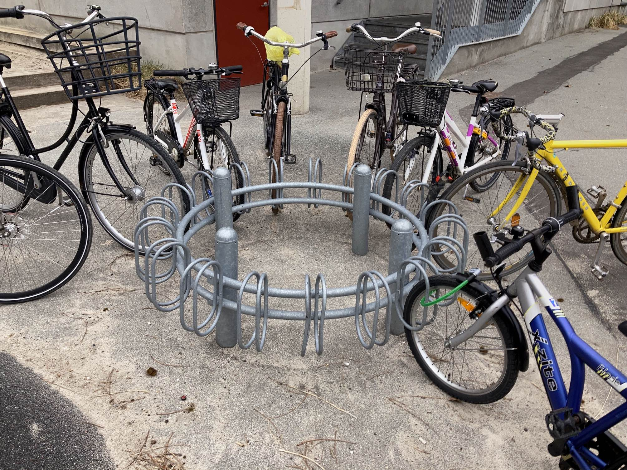 I didn't get to go anywhere fancy today – was planning to make a little trip later on in the day, but then, while waiting for my daughter at the playground, suddenly saw these bikes that I see everyday, in a different way. A meeting of different types – all  kinds of circles. From on top of the trampoline.